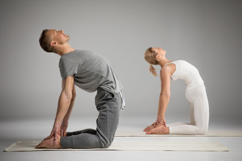 camel yoga pose with partner