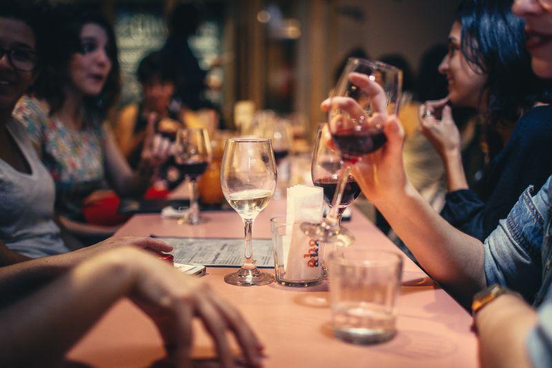 adults enjoying dinner together