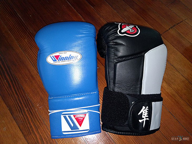 two different branded boxing gloves
