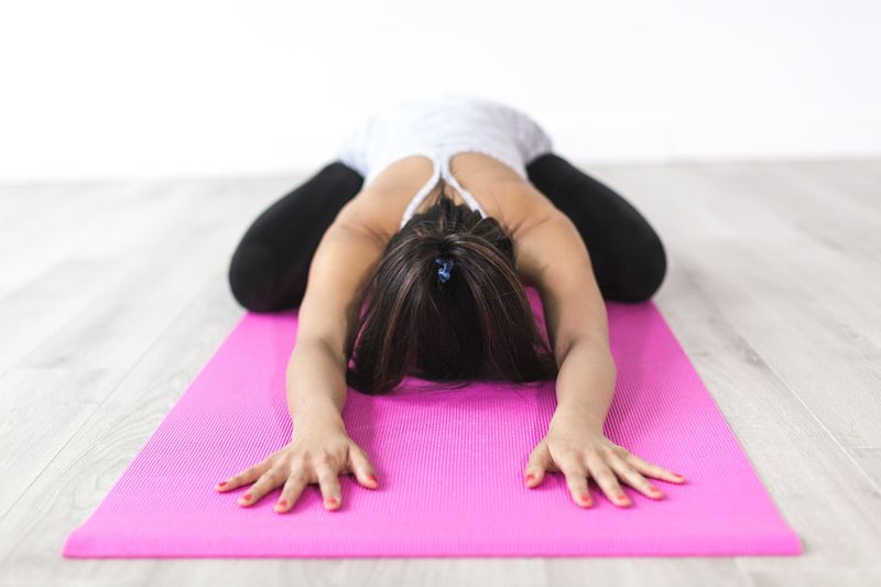 yoga pose with back stretch