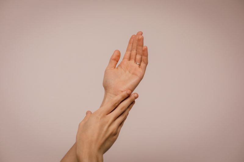 one hand massaging another strained