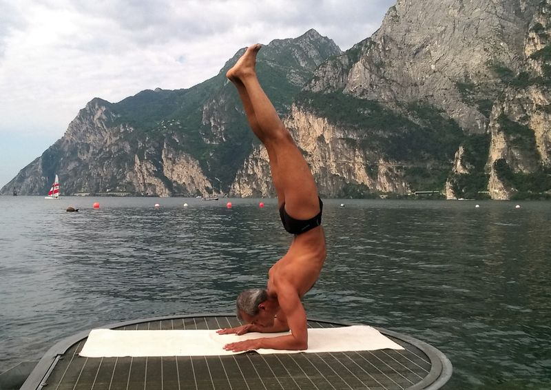 praticing yoga by lake garda in italy
