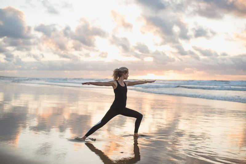 vinyasa yoga on the beach