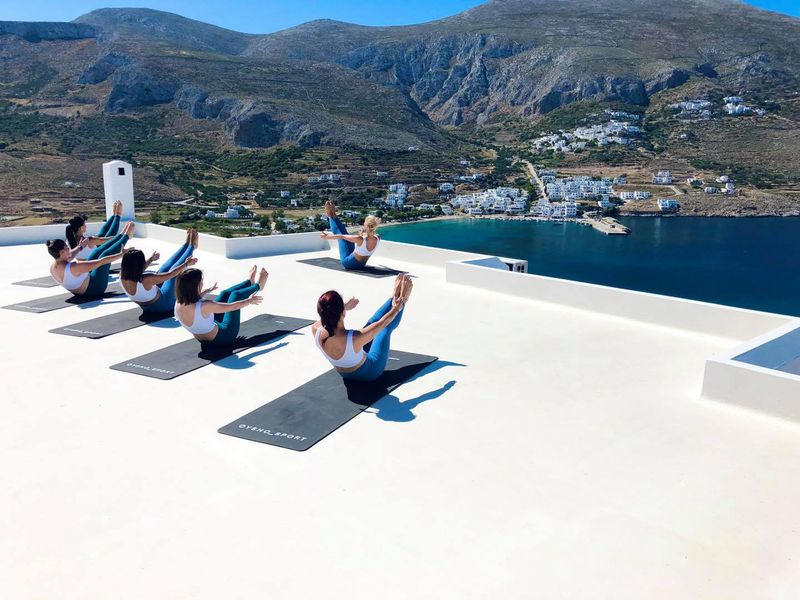 yoga class overlooking a Cycladic island in greece