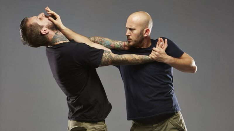 two men fighting krav maga