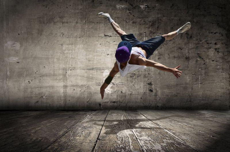 man doing acro yoga