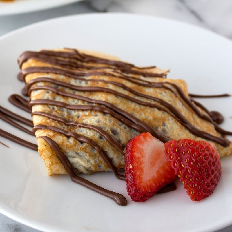 a plate of nutella banana crepes