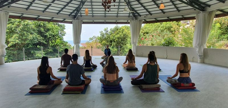 group meditating in thailand