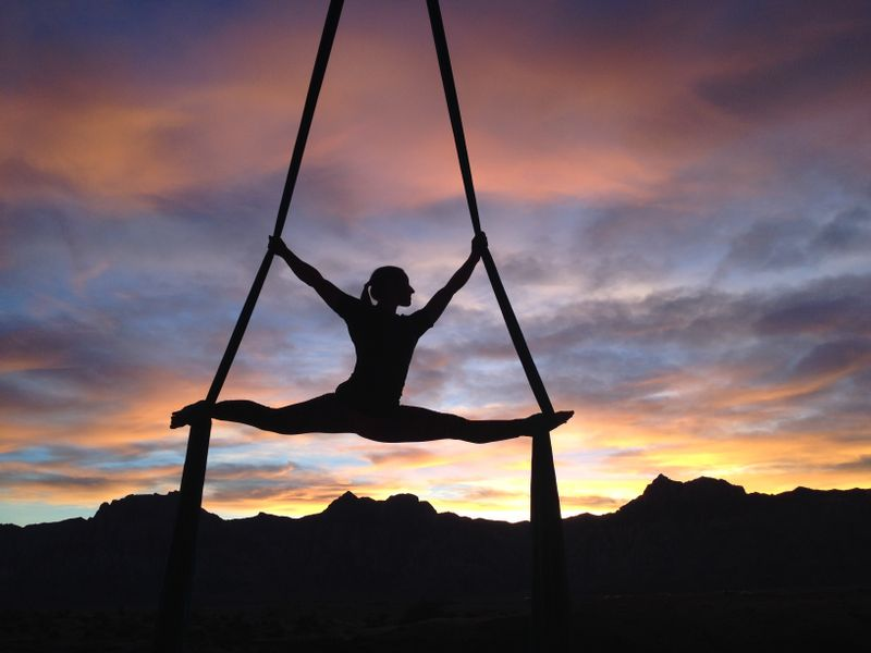 aerial yoga silhouette woman sunset