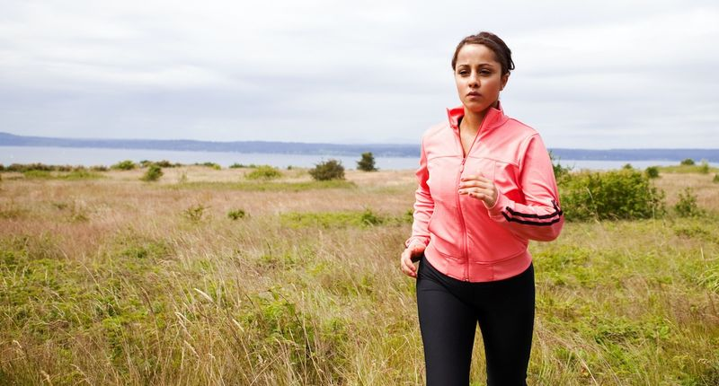 woman pink jacket running exercise plan