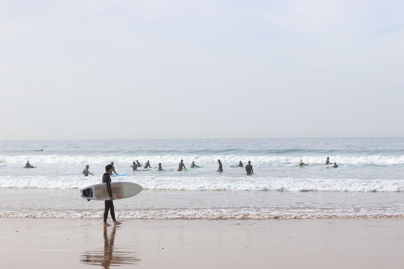 a group of surfers in morocco