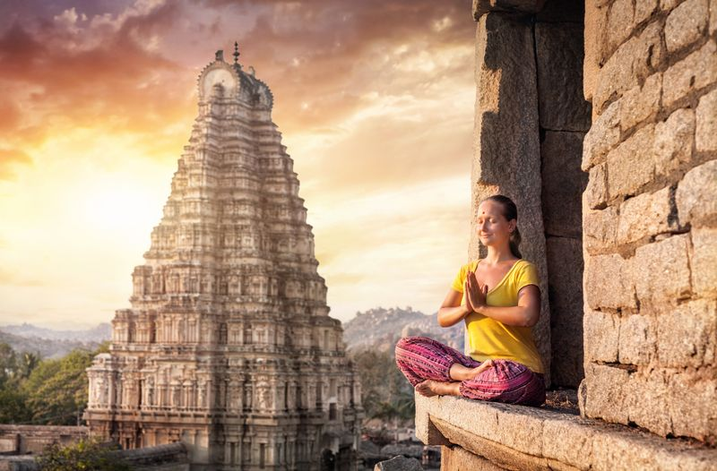 striking a yoga pose in India
