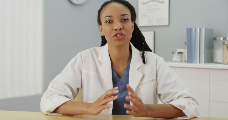 woman doctor talking in front of camera