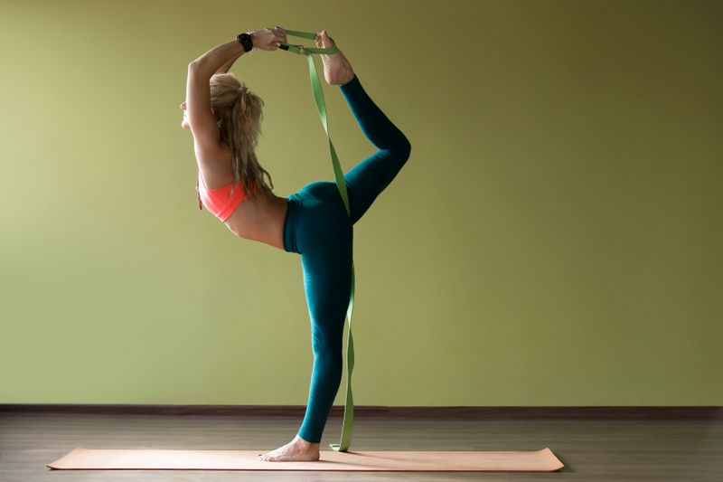 woman with comfortable yoga clothes leg up