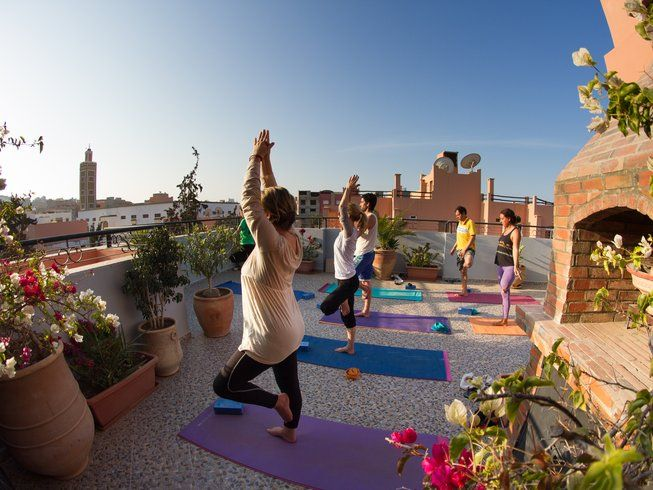 group of women yoga terrace morocco