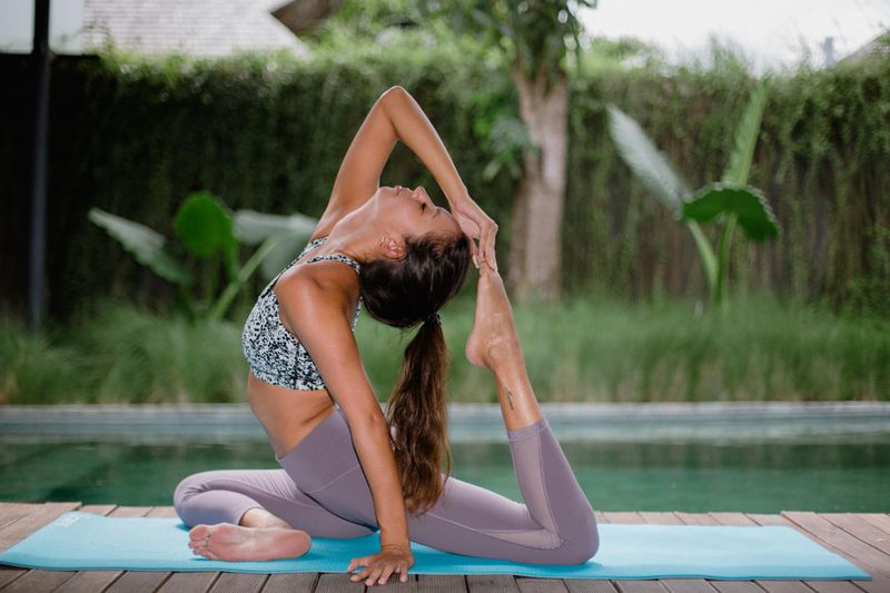 juliette leufke demonstrating a complicated yoga pose