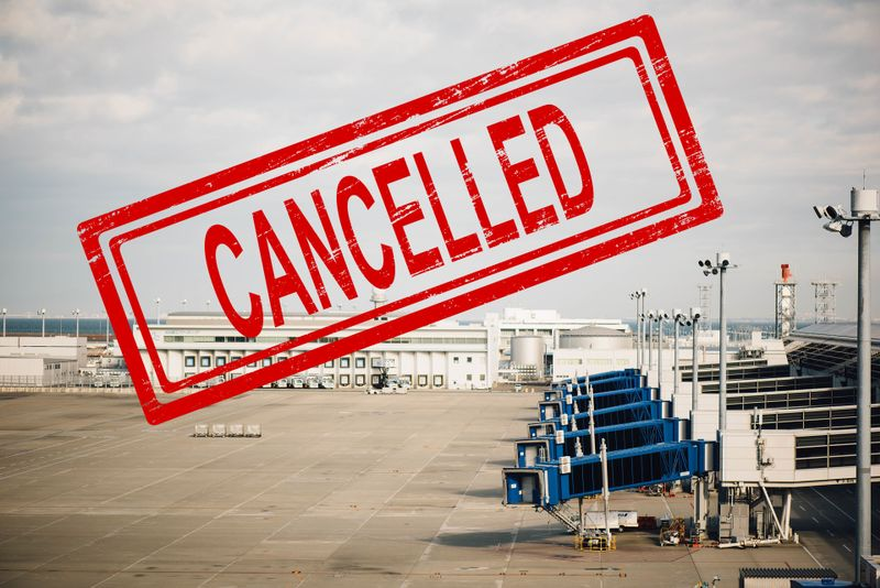 cancelled stamp on airport backgroung
