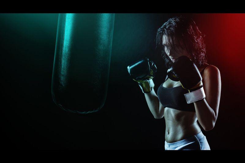 woman boxer in dark light