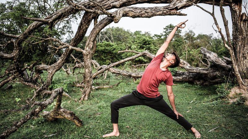 a yogi practicing yoga outdoors