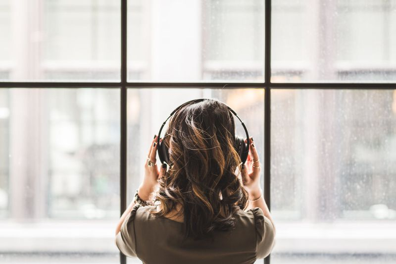 woman wearing headphones meditation
