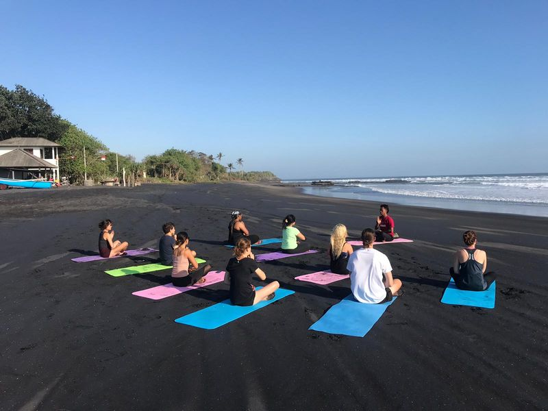 yoga session by the beach