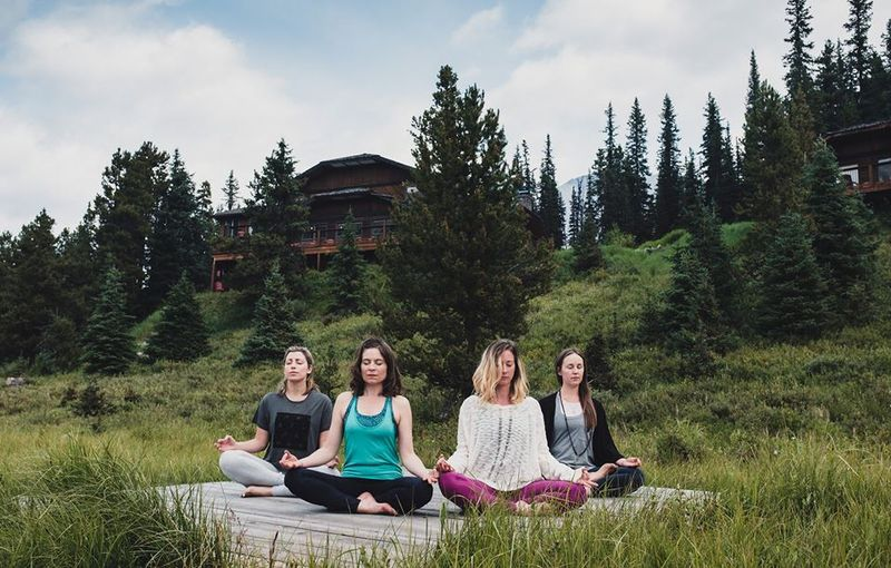 women meditating in canada