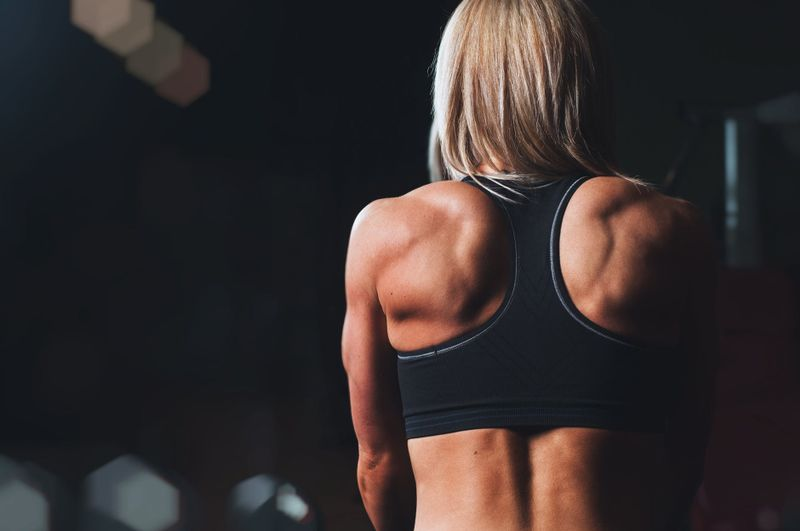 woman with muscular back and sports bra