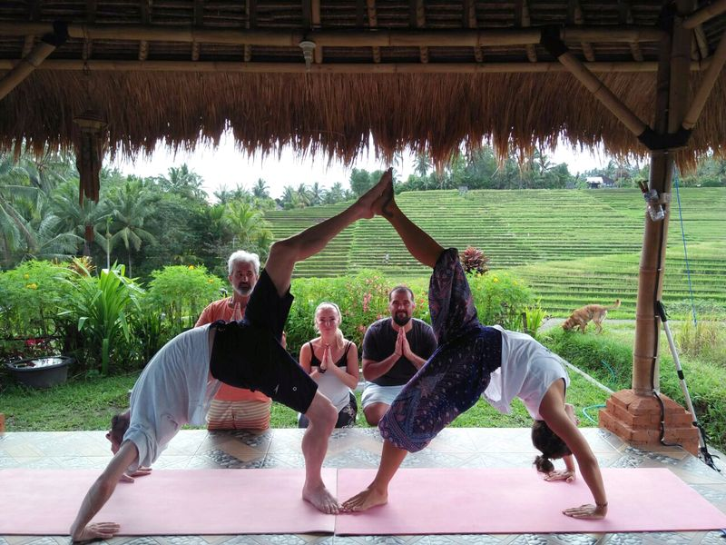 yogis posing on a yoga retreat bali