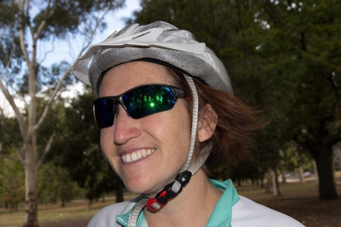 woman with biking helmet and cycling sunglasses