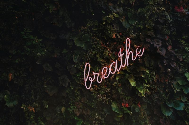 breathe neon sign concept photo