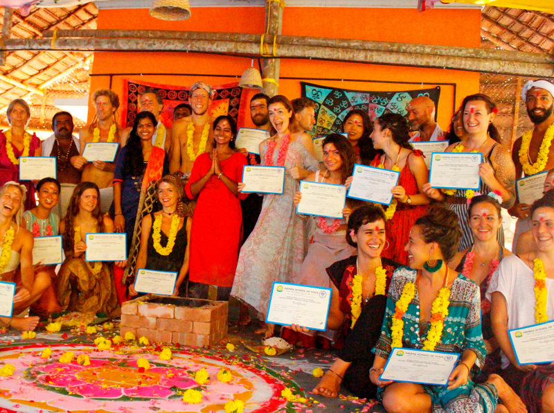 yoga teacher training participants completing course