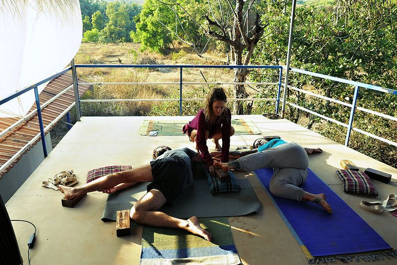 helping students settle into a restorative yoga pose