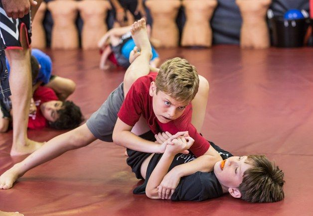 kids locked in mma fighting pose
