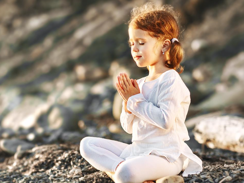 Child sitting in meditation