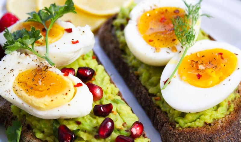 eggs on avocado toast breakfast