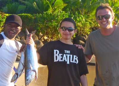 our family foodie trip at taveuni palms - caught tuna with john and tony, cooking the fish later