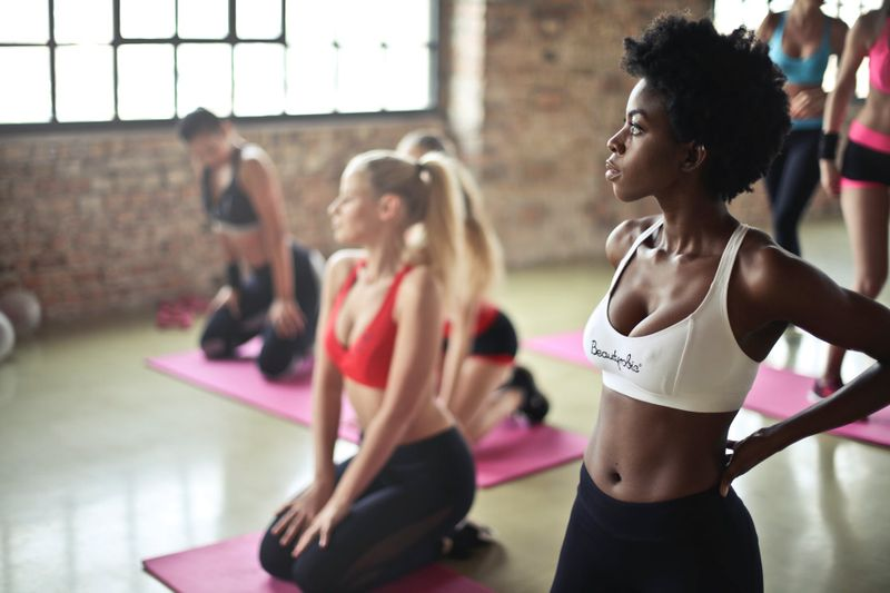 diverse group of women in yoga class