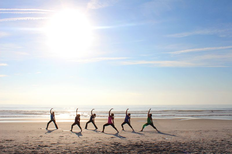 yoga on the beach in lisbon portugal