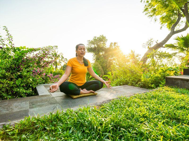 woman meditating on a meditation retreat