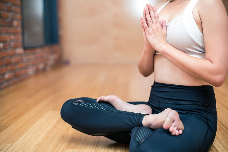 woman in lotus position yoga