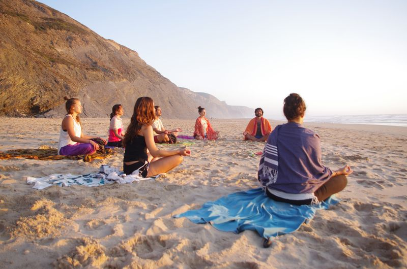 alljezur portugal group of yogis on the beach