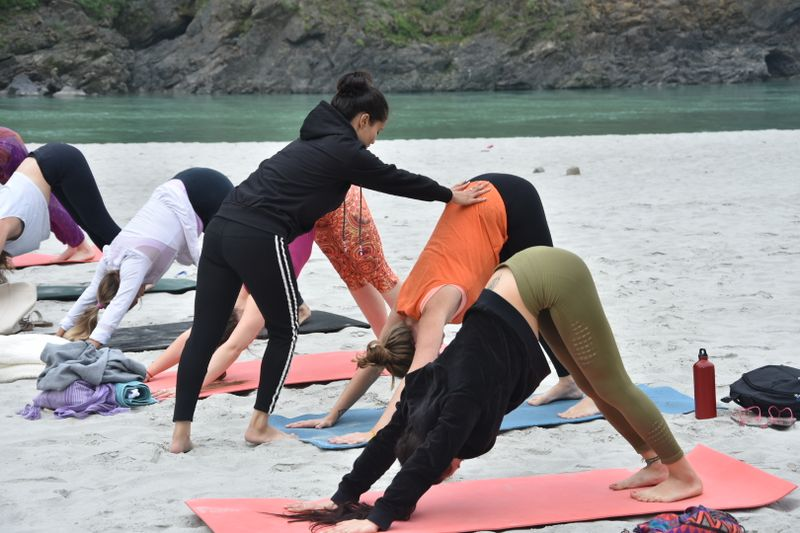 vinyasa yoga class on the beach