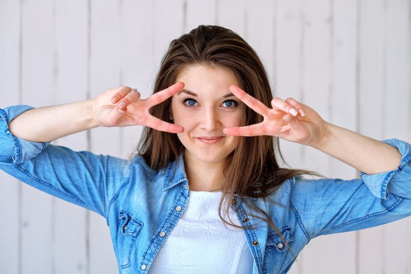 woman doing face yoga moves