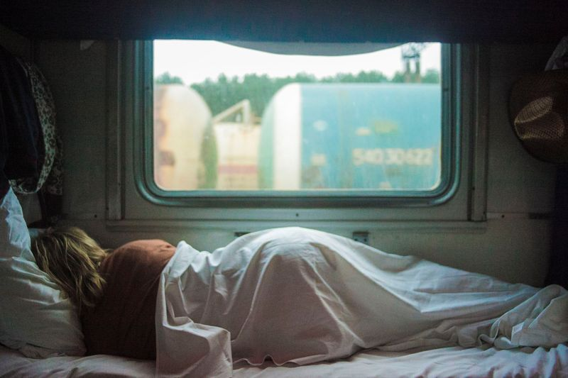 woman sleeping in trailer
