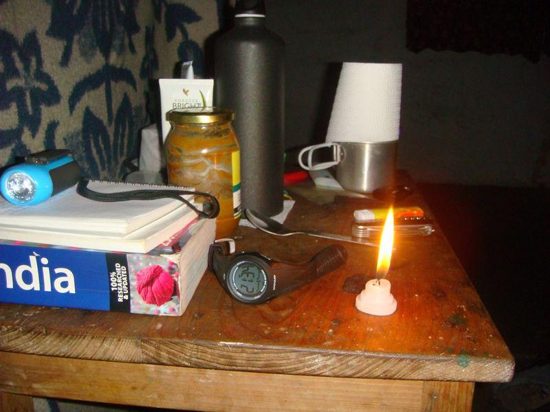 inside the yogi cabin India bedside table candle