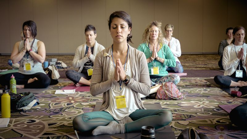 group of women practicing meditation