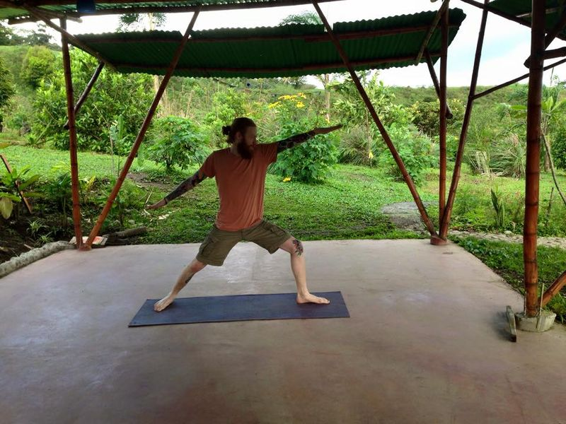 man doing warrior pose in lake arenal area