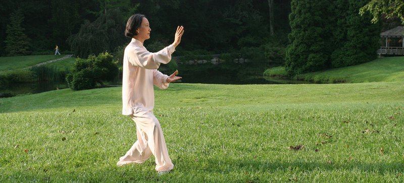 practicing Tai Chi outdoors