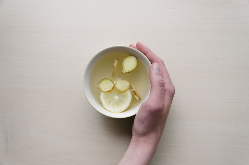 a cup of water with ginger and lemon