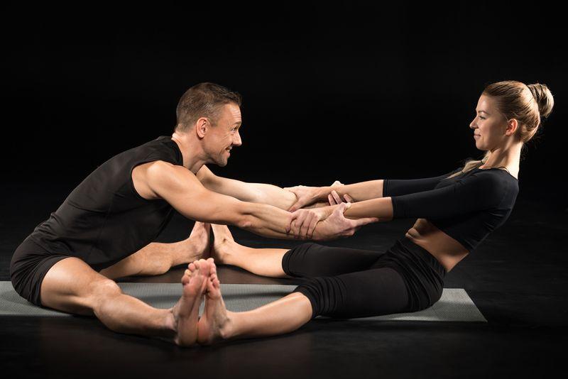 partner forward fold yoga pose